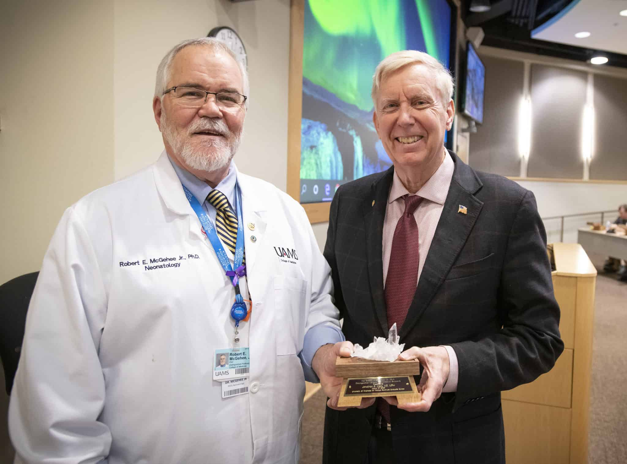 Dean McGehee with Dr. Clark and token