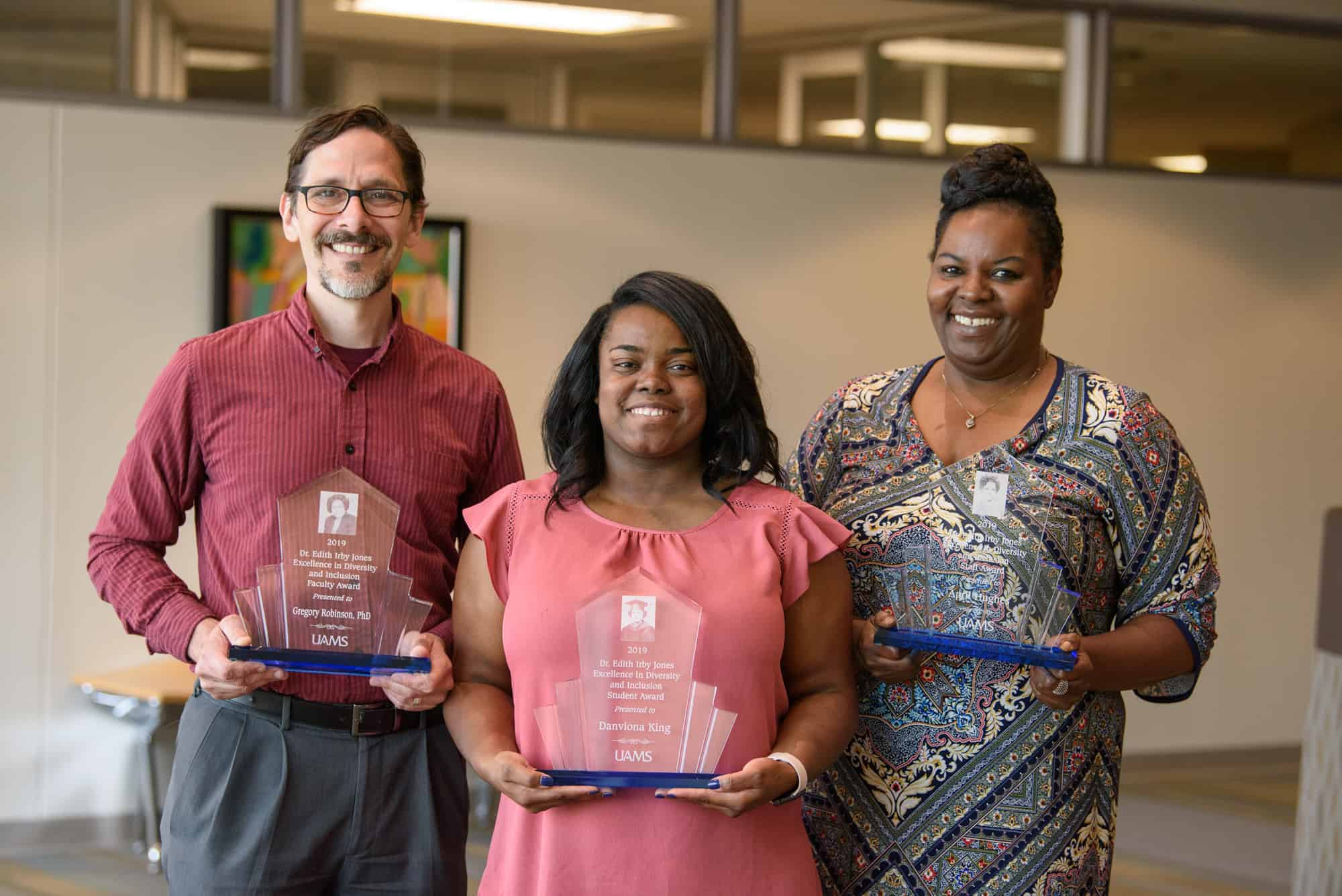 Greg Robinson (left) was the faculty recipient of the Dr. Edith Irby Jones Excellence in Diversity and Inclusion Award for his work with a transgender language clinic.