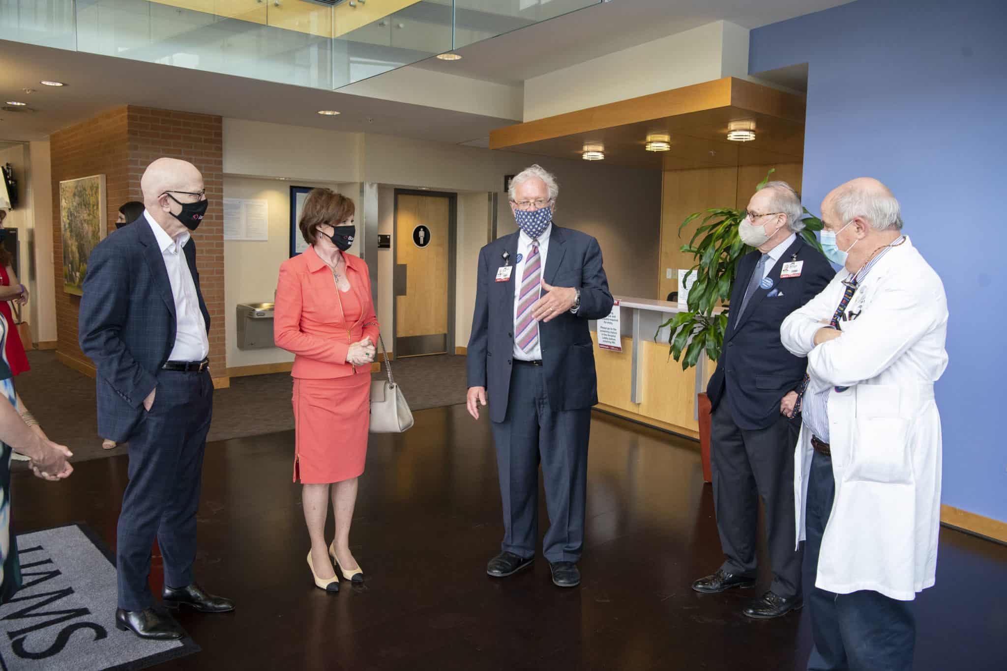 George and Linda Gleason (at left) chat with G. Richard Smith, M.D. (center), David Ashmore and R. Lee Archer, M.D., prior to the presentation of a $100,000 check to be split equally between the Psychiatric Research Institute and Department of Neurology.
