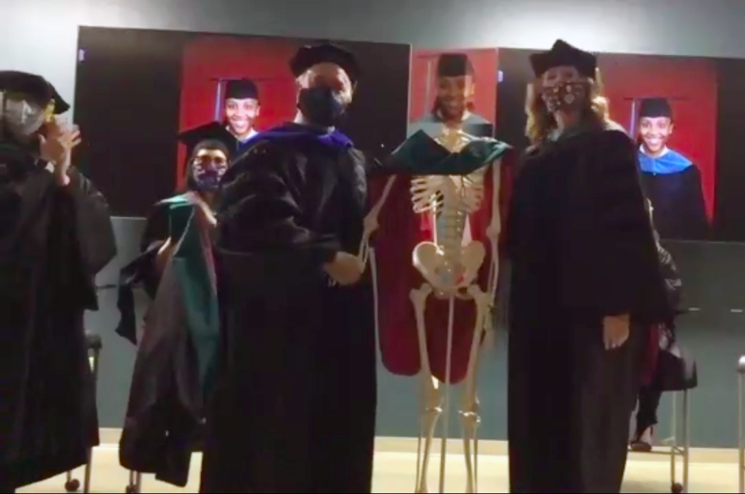 The College of Health Professions Physical Therapy program used skeletons as stand ins for the students in their hooding ceremony.