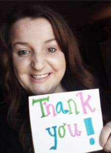 Intern with Thank You sign