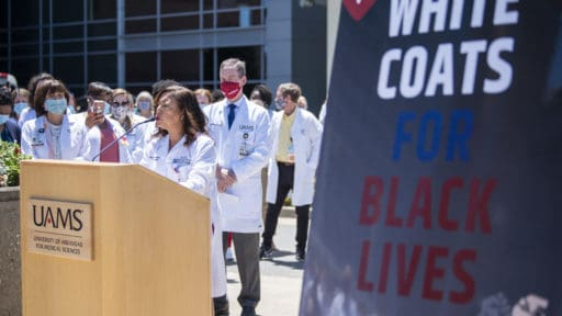 Gloris Richard-Davis, M.D., MBA, speaks at the White Coats for Black Lives event, taking a stand against systemic racism.
