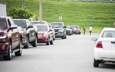 Hundreds of people in their vehicles lined up at the drive-thru to get tested for COVID-19.