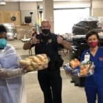 Deb Hutts, Sgt. Greg McKinney and Yukari Juniel offer thanks for lunches donated by members of the Arkansas Legislature to those working COVID-19 screening sites at UAMS.