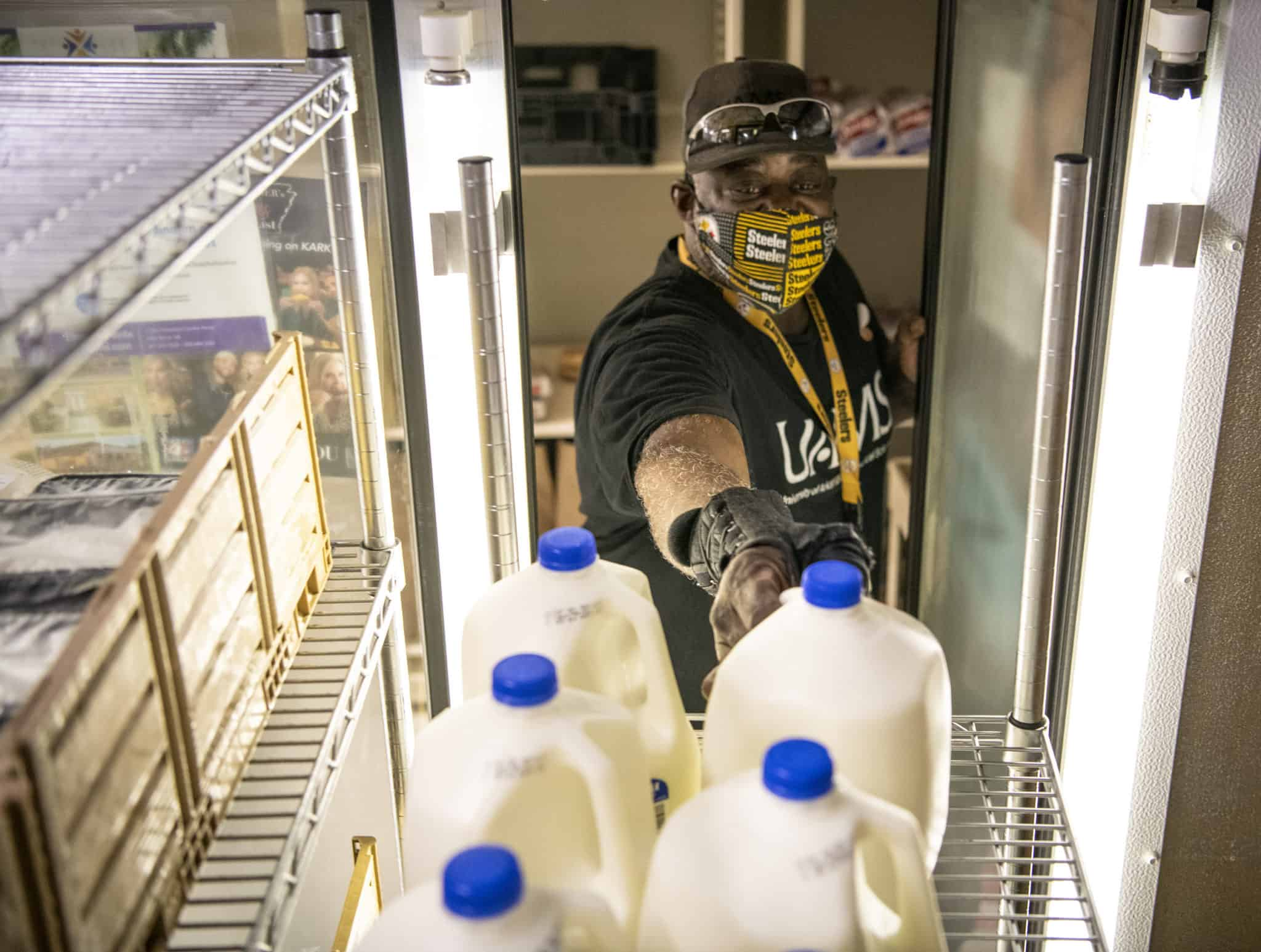 Calvin Tunstall picks up a gallon of milk at Stocked & Reddie. The food pantry celebrated its first birthday in July.