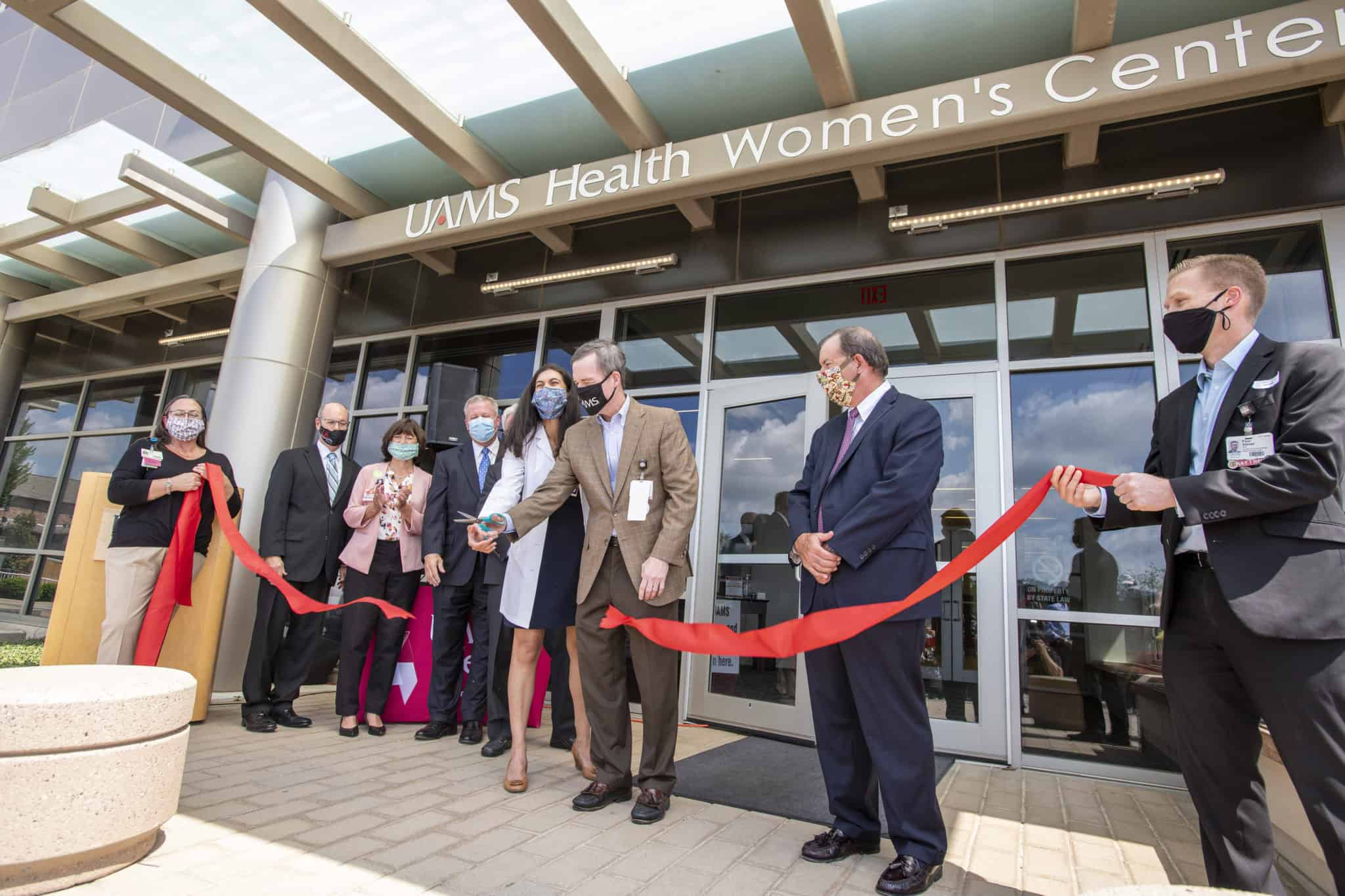 Dr. Patterson cutting clinic ribbon