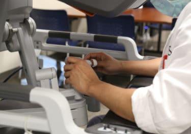 Dr. Pagteilan at the robot controls