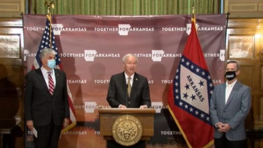 Gov. Asa Hutchinson, center, introduces U.S. Department of Health and Human Services Deputy Secretary Eric Hargan at new conference at the Capitol.