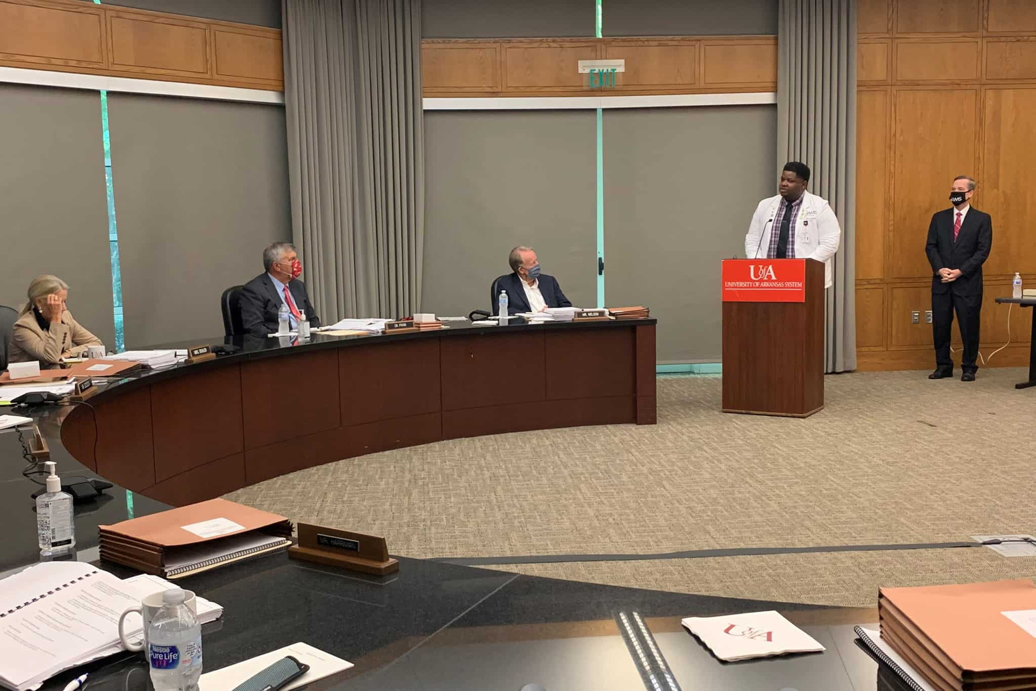 Byron Johnson at the podium