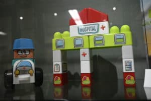 A Fisher-Price hospital is among the toys on display.