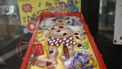 Different versions of the classic board game Operation are included in the exhibit.