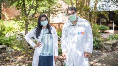 Dr. Paydak and Dr. Kovelamudi outdoors