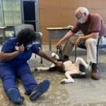Kewanna Gibbons scratches Lucy's belly during pet therapy Sept. 9.