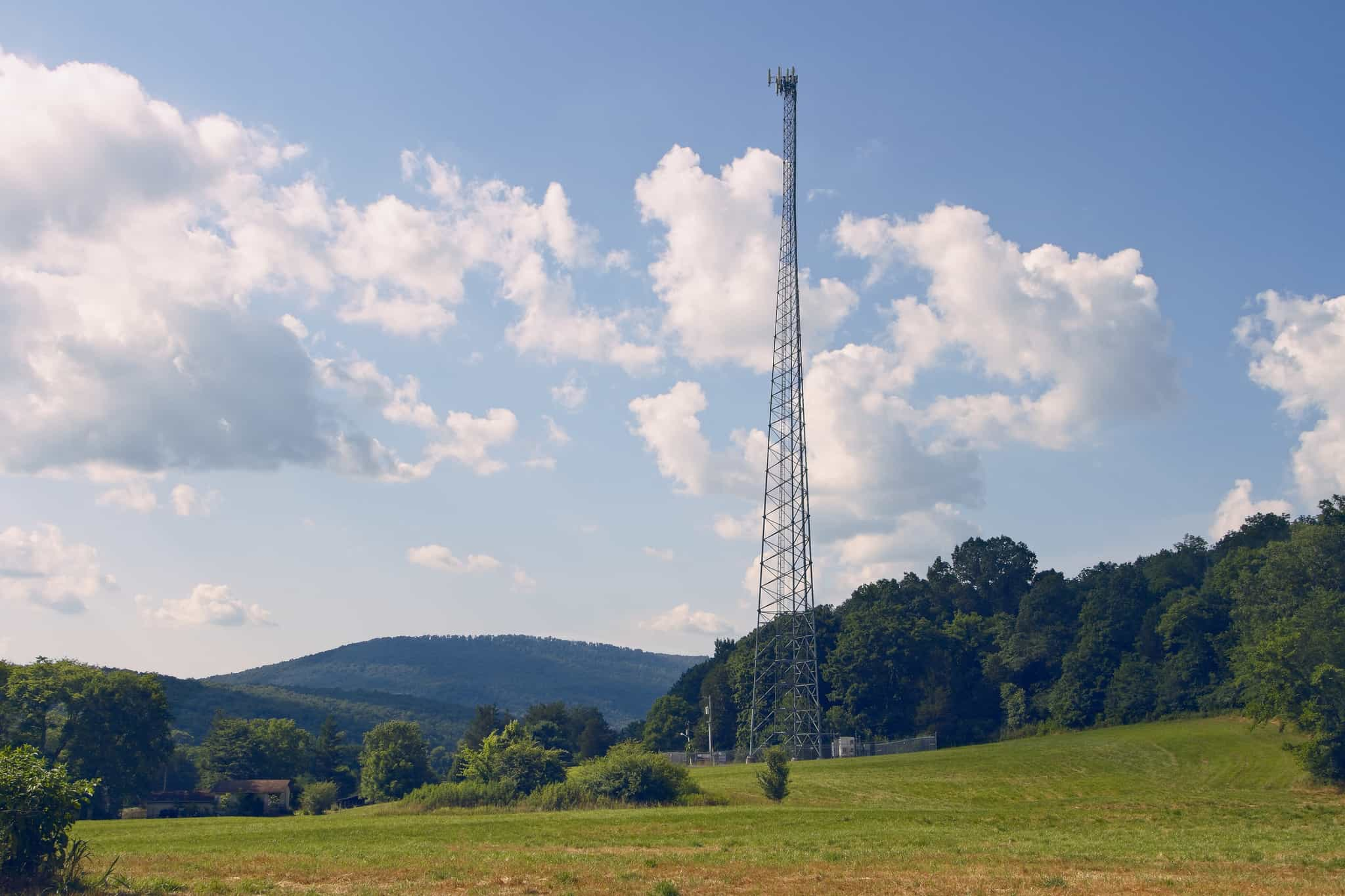 Communication tower standing tall in the country side of Alabama.