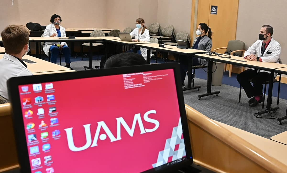 Priya Mendiratta, M.D., second from left, talks to UAMS students, residents and fellows about the new Geriatric Buddy program.