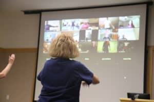 The class consists of both virtual and in-person participants.