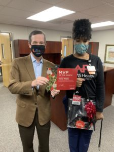 Chancellor Cam Patterson, M.D., MBA, presents Keira Webb with the November MVP of the Month award.