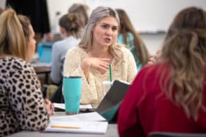 Ashlyn Elliott (center) talks with her classmates during an occupational therapy class in January.