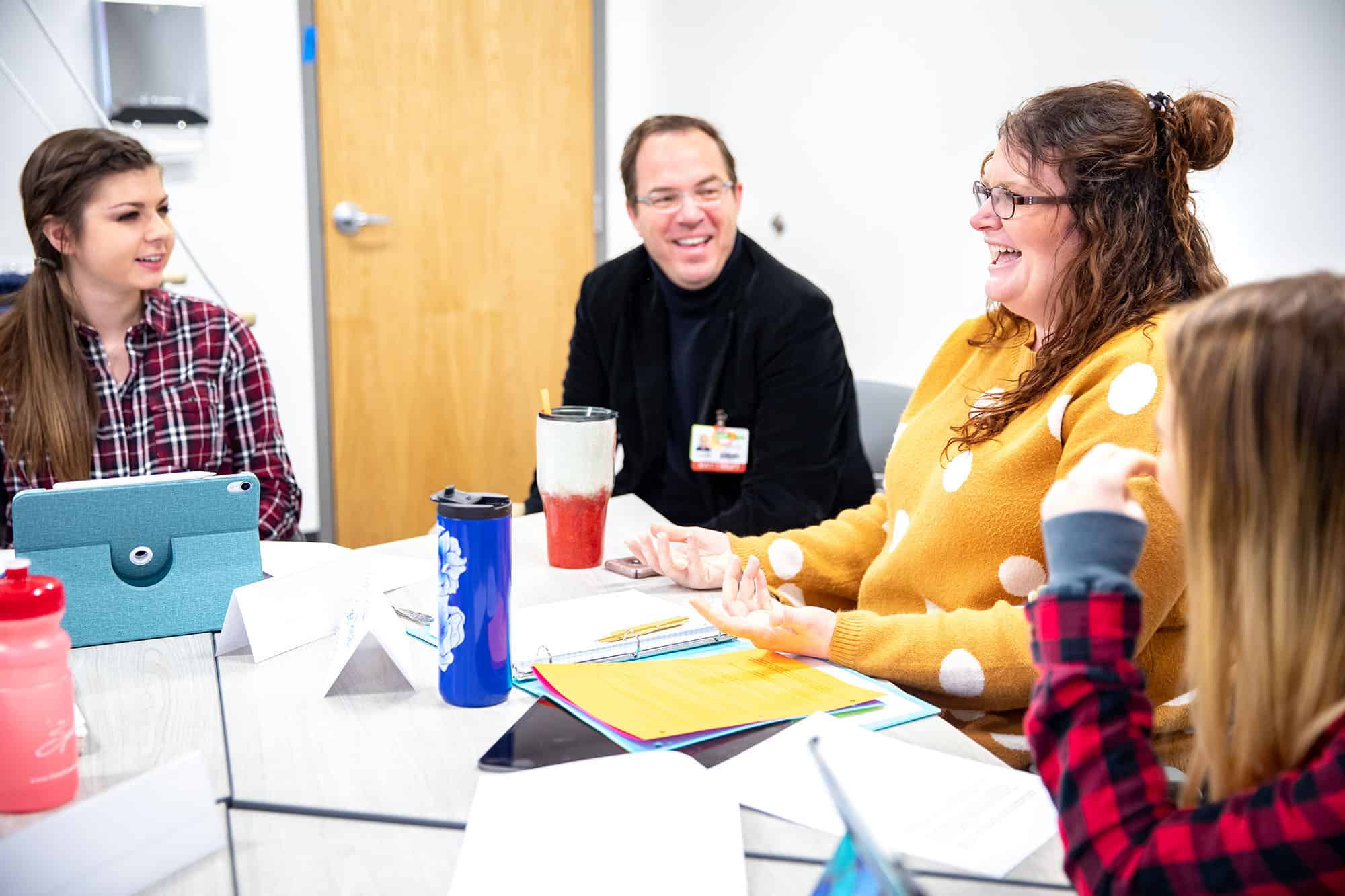 Mark Koch, OTD, (center) speaks with students Awbrey Gibby and Sarah Arenas during a class in January.