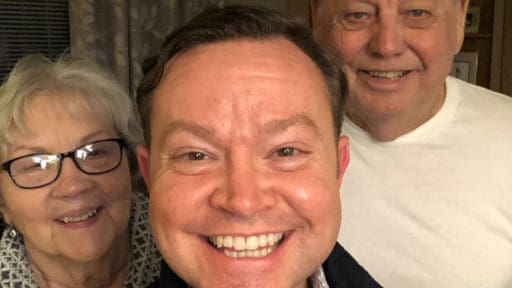 Flanked by his mother and father, Grady O. Brown, center, takes a family photo in early 2020 before the COVID-19 pandemic in the U.S. He supports his mother, Virginia, in caring for his father, who also is named Grady Brown.