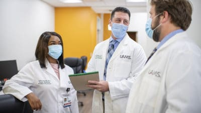 UAMS family medicine residents stop for brief conversation in a hallway at the UAMS Family Medical Center in Batesville.