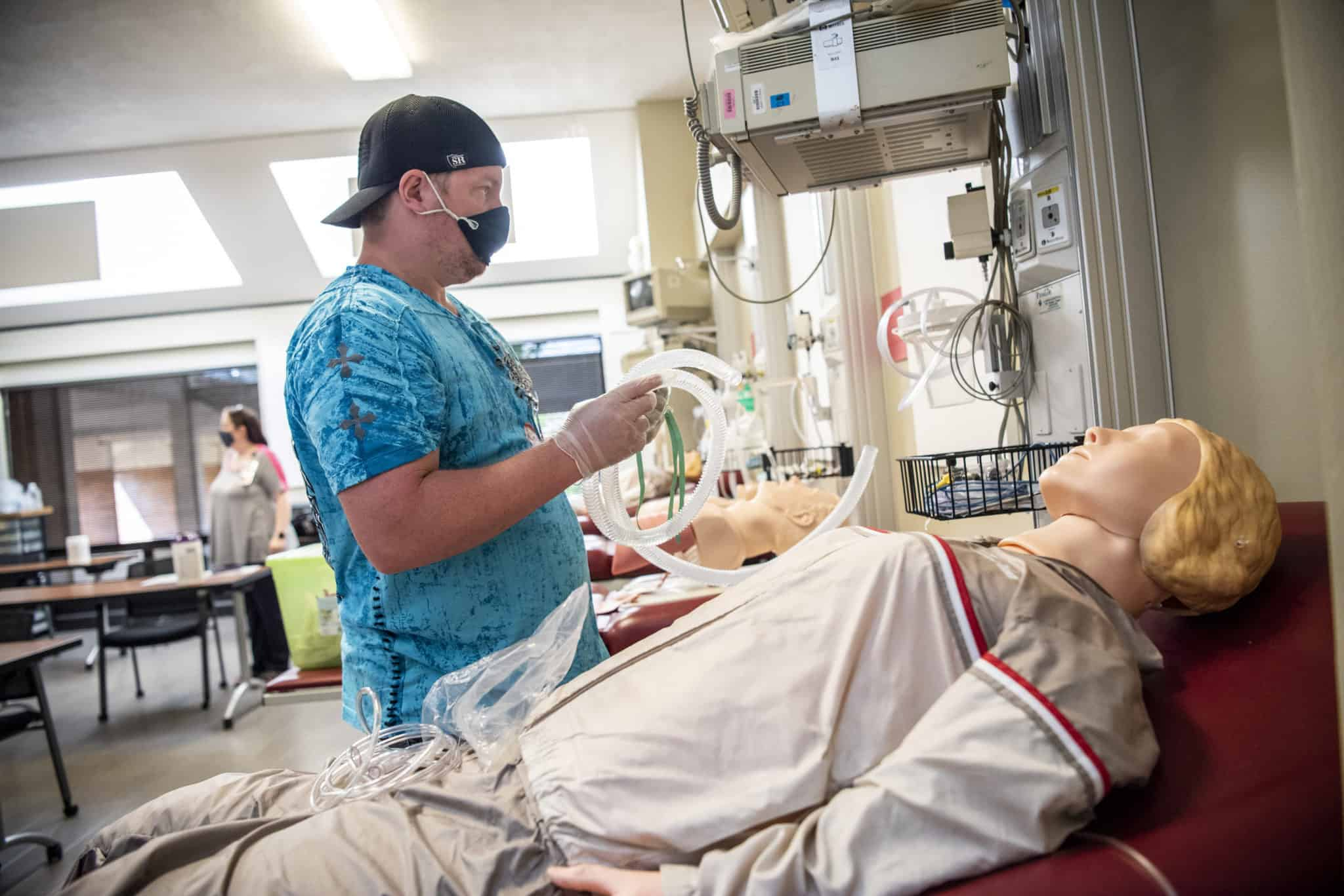 Respiratory Care student John Smith practices setting up an air entrainment mask.