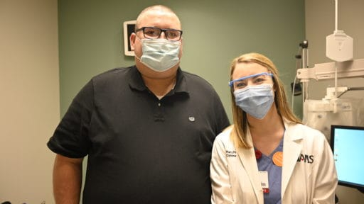 Patient Jeremy Thornton poses with Mary Price, O.D., after an appointment in the low vision clinic at the UAMS Harvey and Bernice Jones Eye Institute.