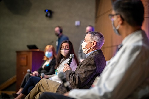 Robert Hopkins, second from right, answers a question during the panel discussion at the Chancellor's Town Hall.