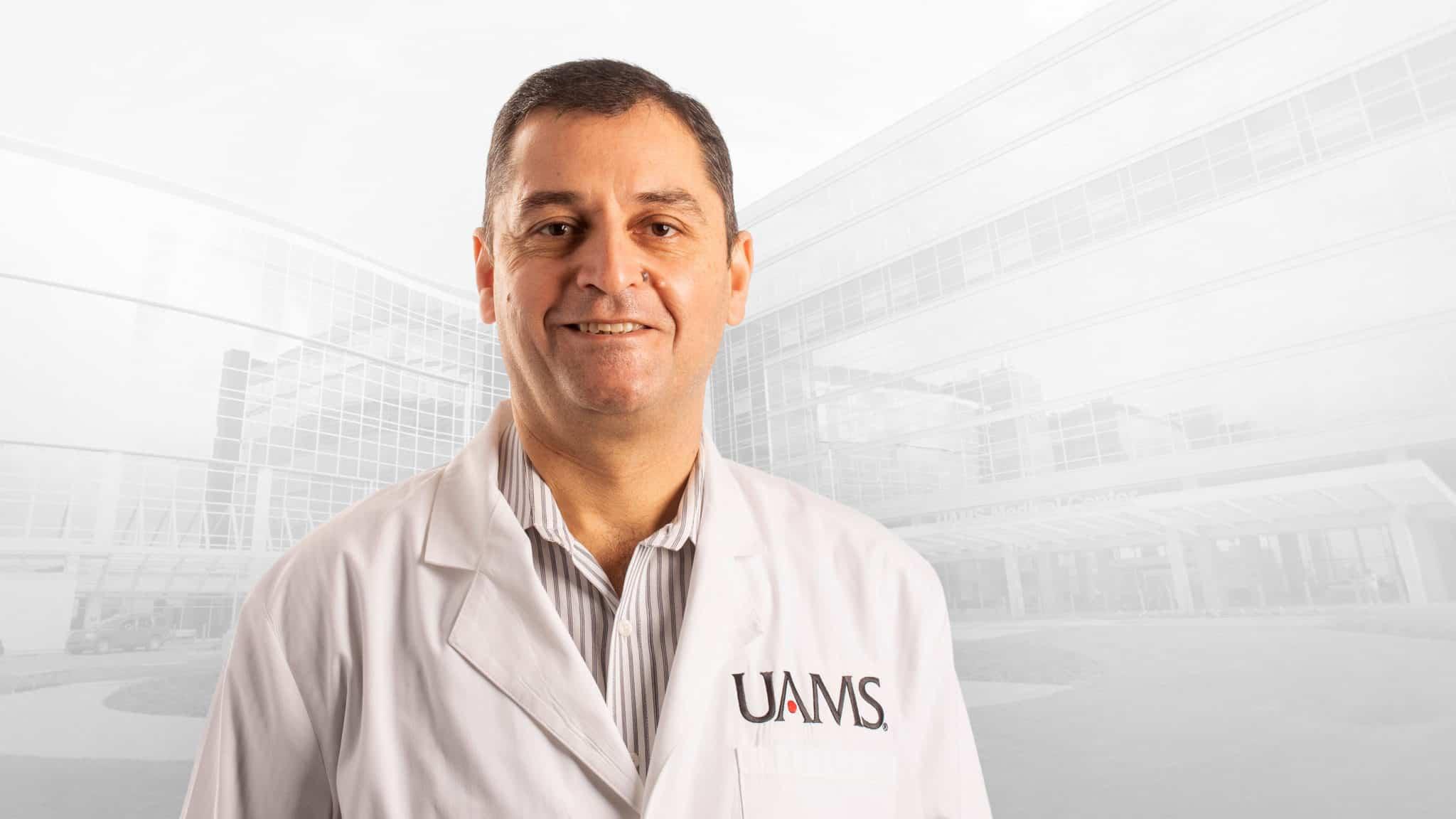 photo of Gaurav Dhar, M.D., in white coat