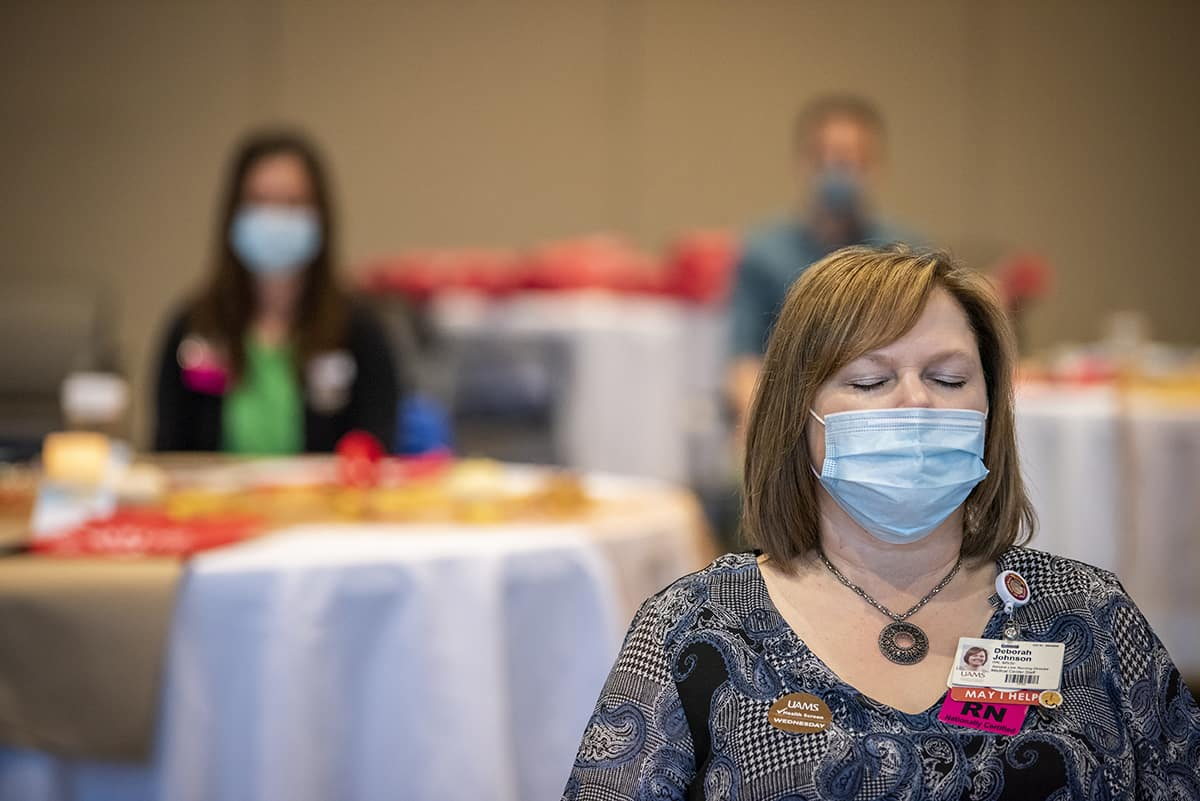 UAMS nurses at a retreat in October meditate as part of a mindfulness exercise led by Paru Thapa, M.D.