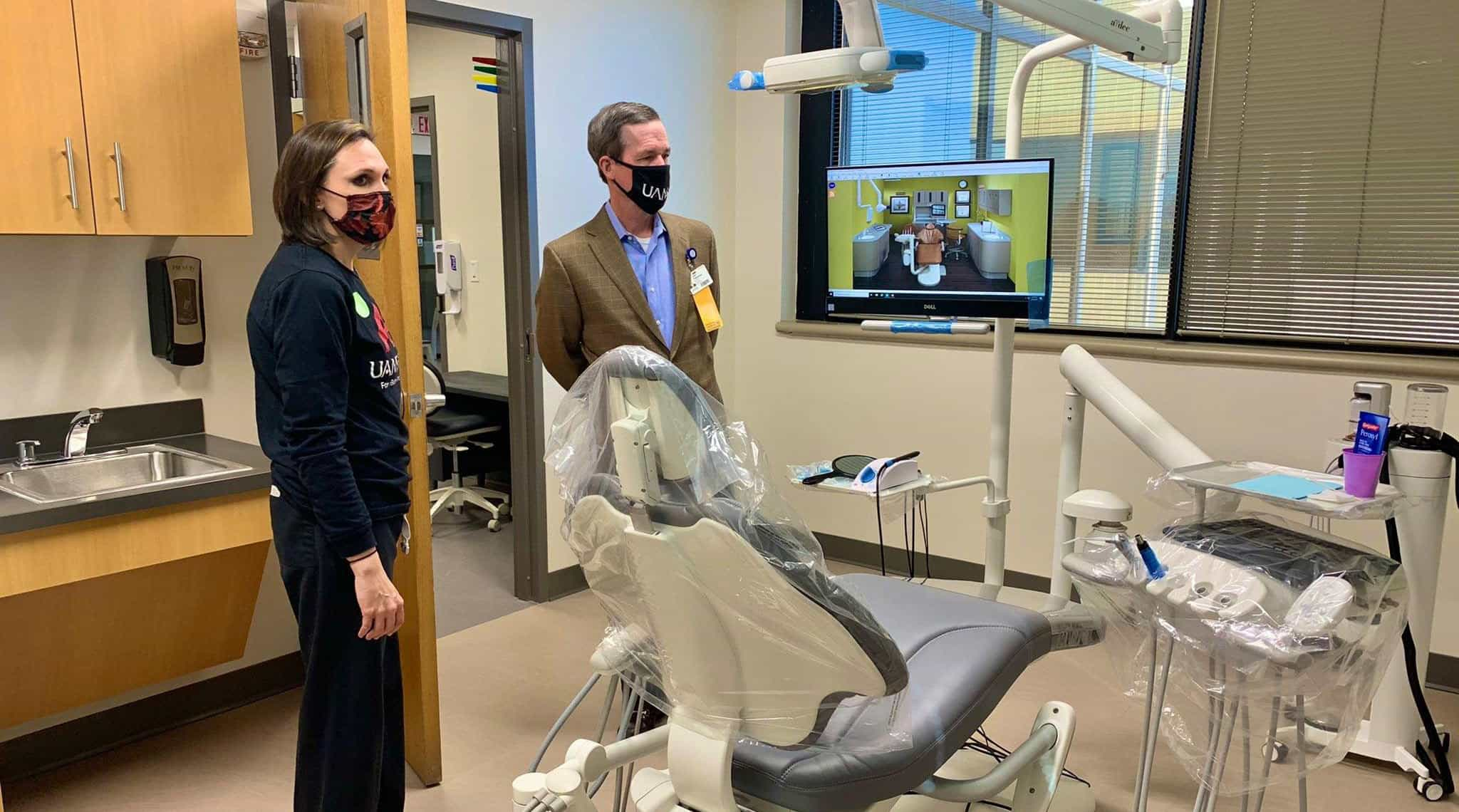 Chancellor Cam Patterson, right, tours the new UAMS Dental Hygiene Clinic in the Freeway Medical Tower.