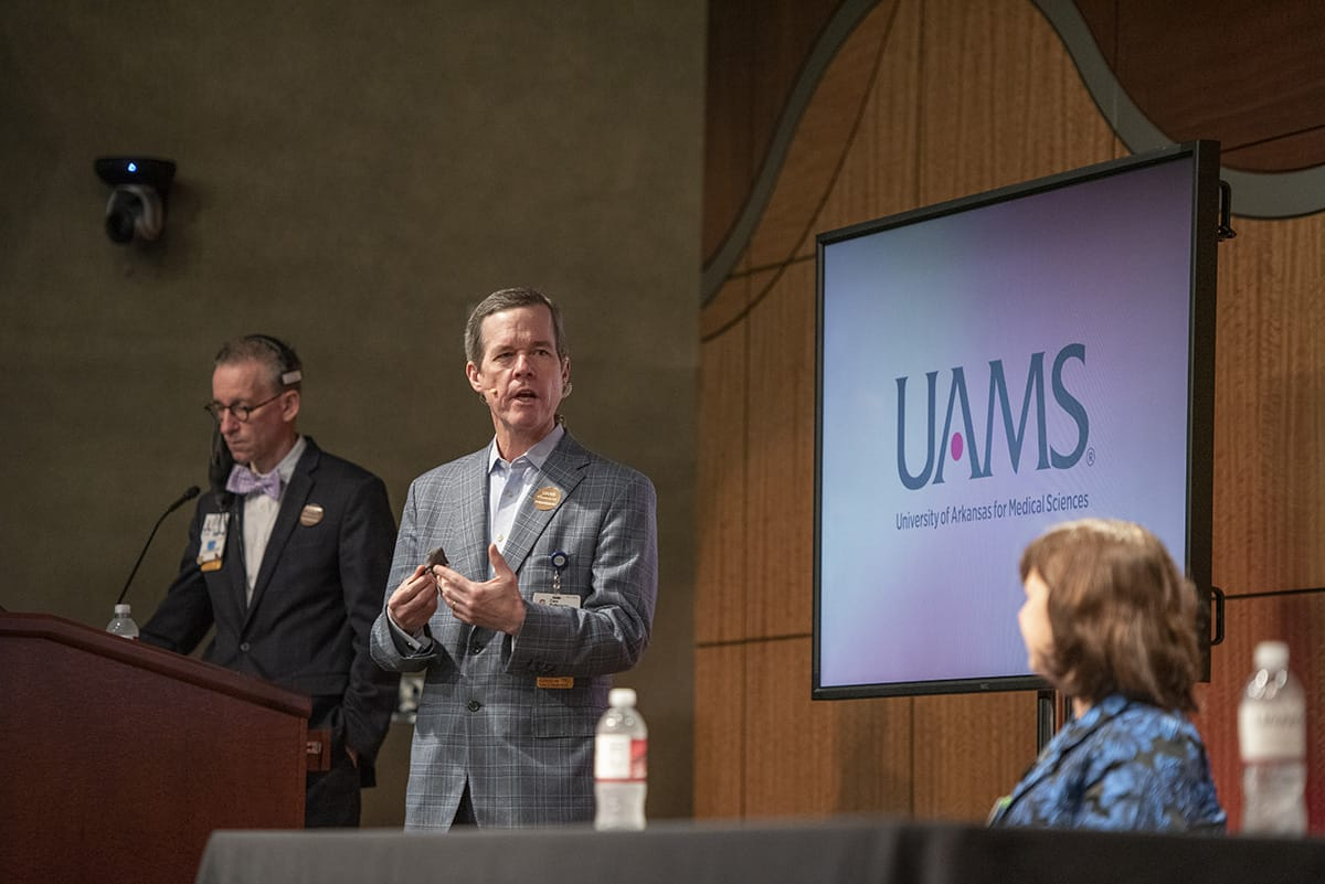 UAMS Chancellor Cam Patteson, center, answers a question in writing from a member of the Town Hall audience that was read out loud by Michael Manley, left, as Provost Stephanie Gardner listens.