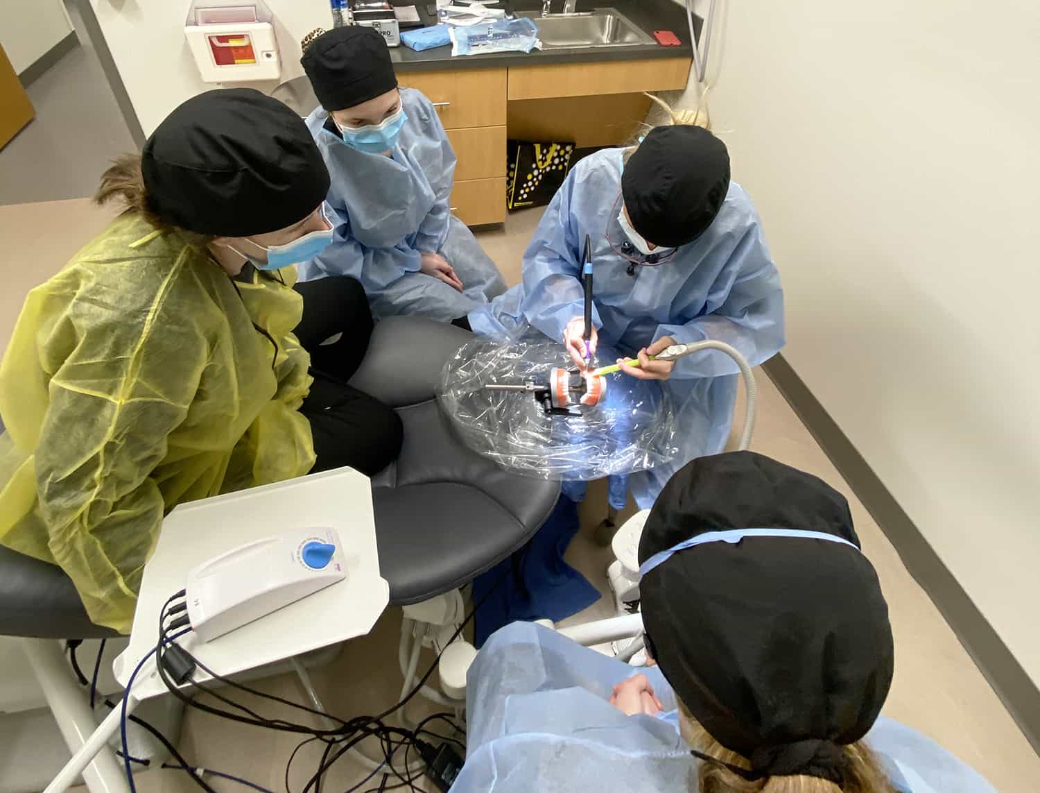 Students at the new UAMS Dental Hygiene Clinic hone their new skills on a practice model set of teeth.