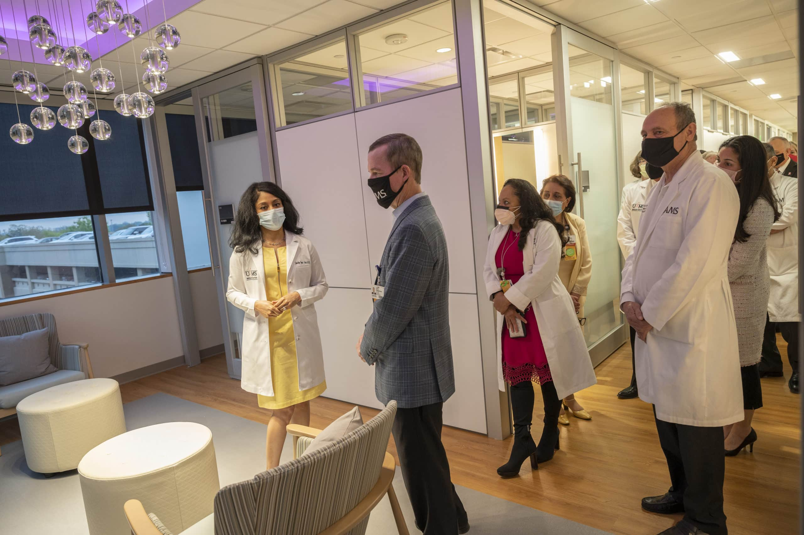 Gwendolyn Bryant-Smith, M.D., (left) shows off the new UAMS Breast Center to Chancellor Cam Patterson, M.D., MBA; Ronda Henry-Tillman, M.D.; Michael Birrer, M.D., Ph.D.; and other staff at the Winthrop P. Rockefeller Cancer Institute.