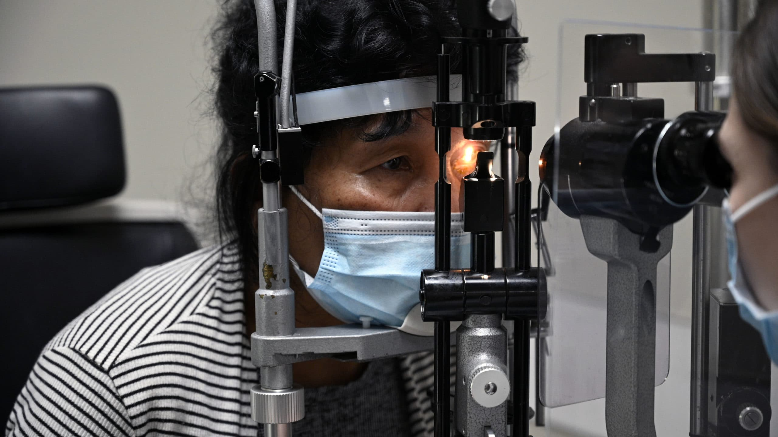Libos Gold, 60, has her left eye examined by Carina Sanvicente, M.D., the day after her cataract surgery.