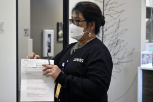 Clinical interpreter Lynda Riklon translates after-care instructions for Marshallese patients at Henry Eye Clinic in Fayetteville.