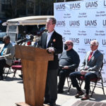 UAMS Chancellor Cam Patterson speaks April 1 at a news conference at Simmons Bank Arena.