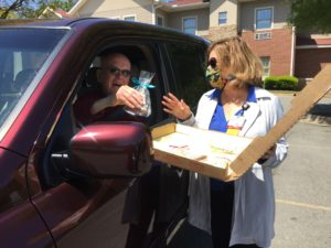 """""""I'm so ready to come back,"""" volunteer Henry Noor told Susan Jones, assistant director of volunteer services and auxiliary as the chatted during the drive-thru. Noor, who volunteers distributing snacks to patients and their family members, is usually the giving the treats instead of receiving them."""