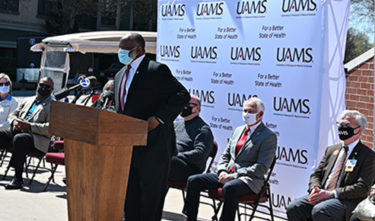 Rev. William Robinson addresses the media and public gathered at Simmons arena for the news conference.