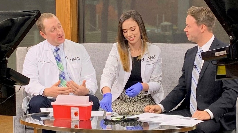 Christopher Johnson, Pharm.D., and then-P3 student Kathryn Barfield demonstrate blood glucose testing with KATV on behalf of APhA Operation Diabetes on November 14, 2019.