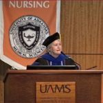 Patricia A. Cowan, Ph.D., RN, dean and professor of the UAMS College of Nursing, addresses graduates.