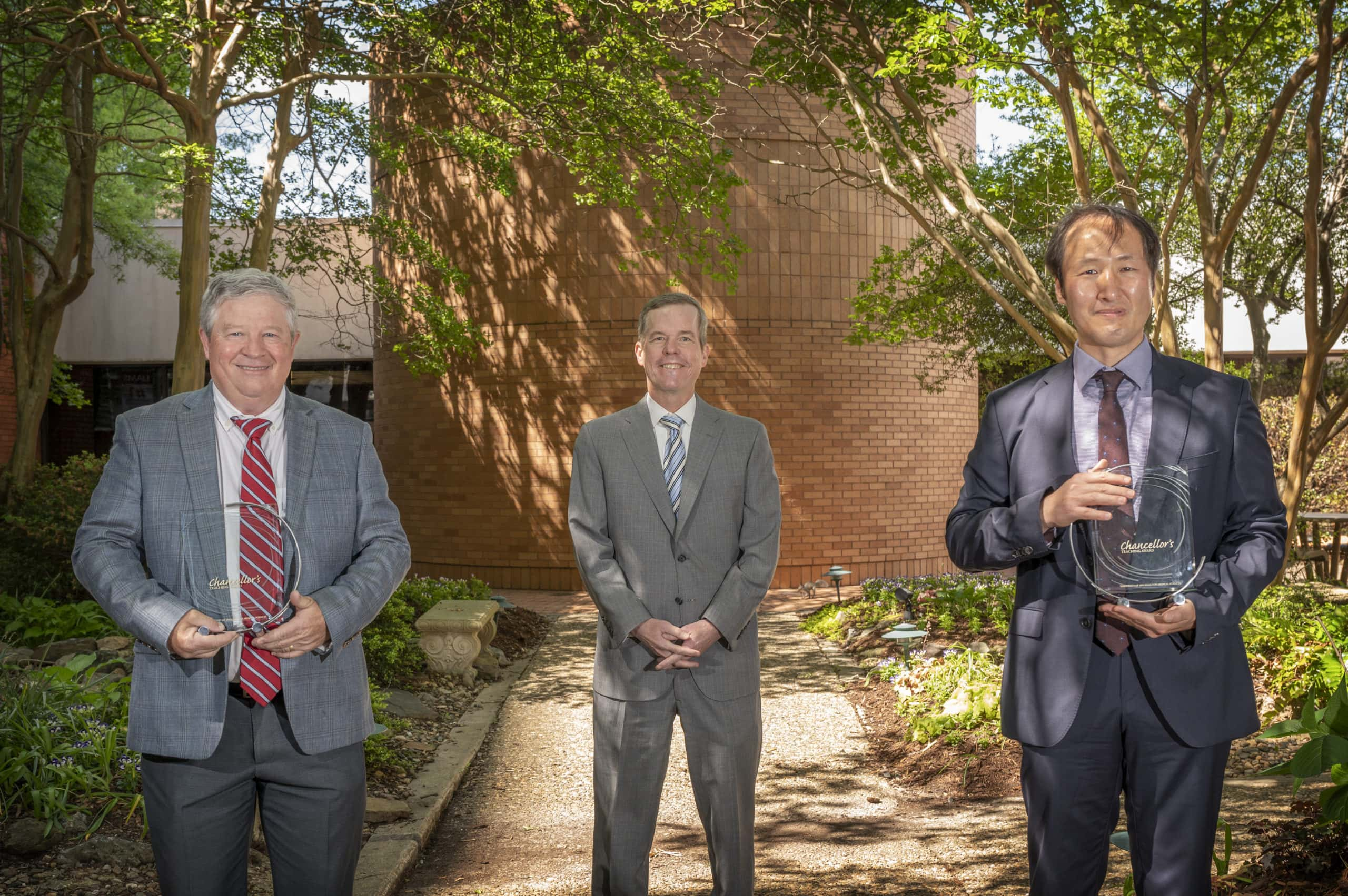 Mick Tilford, Ph.D., Chancellor Cam Patterson, M.D., MBA, and Sung Rhee, Ph.D.