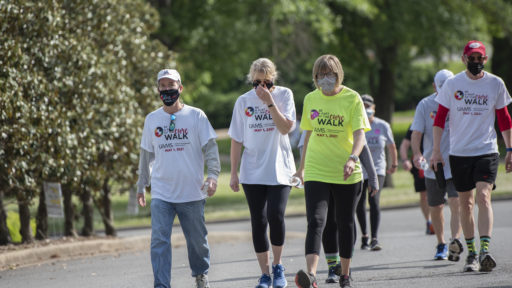 Chancellor Cam Patterson, M.D., MBA, walking with participants during the Be a Part of the Cure Walk on Saturday, May 1.