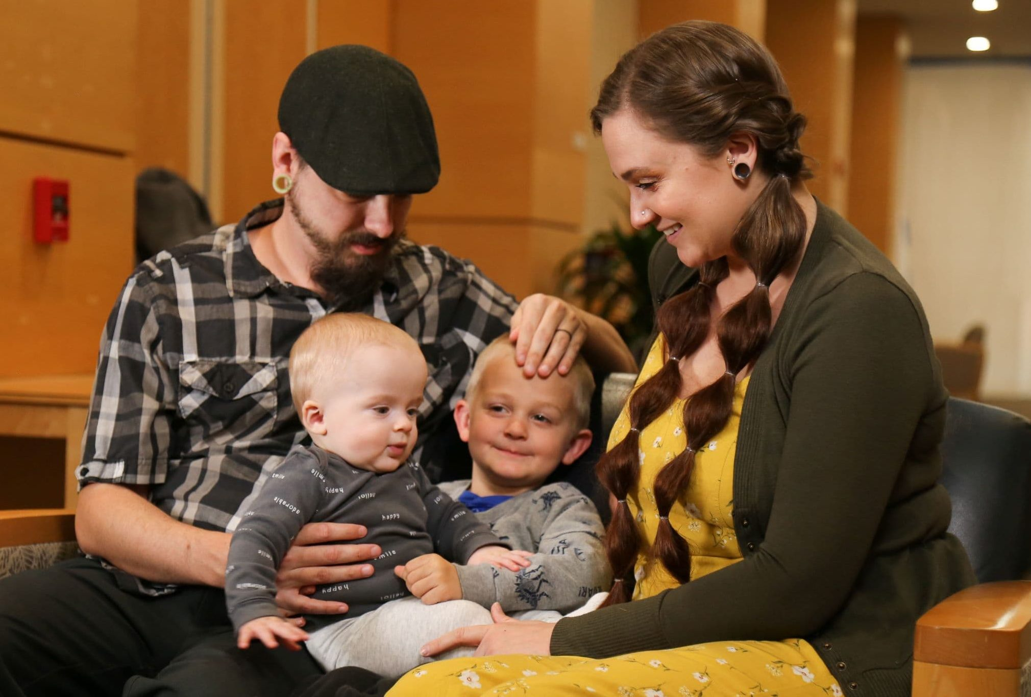 Darrell and Elaine Hurst with their two sons, Oliver (left) and Paxton. Oliver was born last year with Spinal Muscular Atrophy, a disease that could have killed him if not for a newborn screening implemented by UAMS' Kapil Arya, M.D., and a new treatment.