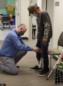 Greg Johnson of Snell Prosthetics & Orthotics fits the prosthesis onto the patient.