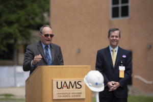 Michael Birrer, M.D., UAMS vice chancellor and director of the Winthrop P. Rockefeller Cancer Institute, discusses the new center as Cam Patterson, M.D., Ph. D., UAMS chancellor, looks on.