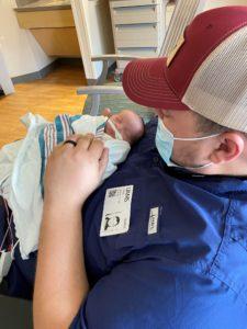Charles Reed with his 2-week-old daughter, Celia Ann