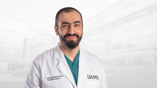 Emmanouil Giorgakis, M.D., in white coat.