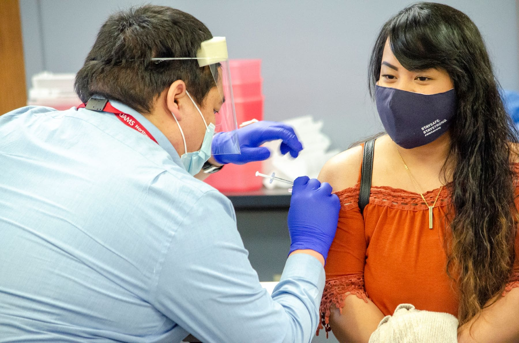A Marshallese resident in Northwest Arkansas receives a COVID-19 vaccine.