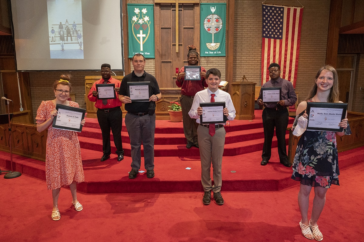 This year's Project SEARCH graduates hold their diplomas after the ceremony at St. Andrew's United Methodist Church in Little Rock. They are, left to right, Donna Pelle, Unard Bush, Marshall Neal, Jodarious Riggins, Matthew Henley Greenwalt, Joe Randall and Molly Stump.